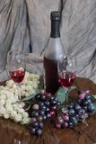 Grapes and wine. Wine, wine glasses, with an array of grapes to set the mood for an elegant evening for that special someone Royalty Free Stock Photography