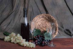 Grapes and wine. Wine, wine glasses, with an array of grapes to set the mood for an elegant evening for that special someone Stock Photo