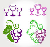 Grapes and wine glasses Stock Images
