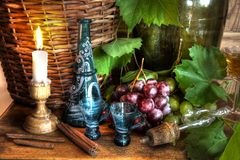 Grapes,wine,grapevine,decanter and candle Royalty Free Stock Photos
