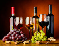 Grapes and wine. Still life with grapes, red, white and rose wine Stock Photo