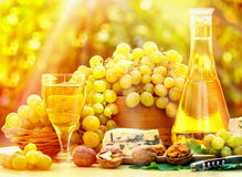 Grapes and wine on table Royalty Free Stock Images