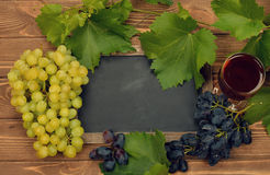 Grapes, wine and writing board Stock Photography