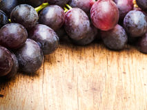 Grapes on Wood Royalty Free Stock Photography