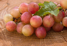 Grapes on wood Stock Image
