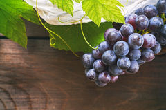 Grapes on wooden background Stock Photo