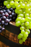 Grapes on wooden barrel Royalty Free Stock Images