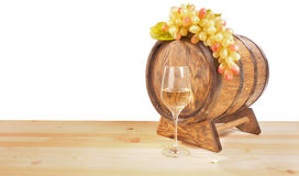 Grapes and wooden barrel on a white backgroun Royalty Free Stock Image