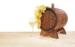 Grapes and wooden barrel on a white backgroun Stock Photography