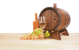Grapes and wooden barrel on a white backgroun Stock Image
