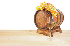Grapes and wooden barrel on a white backgroun Royalty Free Stock Photo
