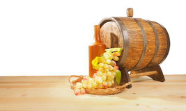 Grapes and wooden barrel on a white backgroun Royalty Free Stock Photos