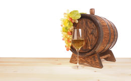 Grapes and wooden barrel on a white backgroun Stock Images