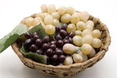 Grapes in the wooden bowl Stock Photos