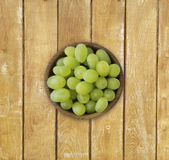 Grapes in a wooden bowl. Royalty Free Stock Photos