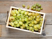 Grapes in wooden box stock image