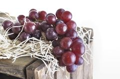Grapes on a wooden crate Royalty Free Stock Photography