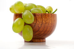 Grapes in a wooden cup Royalty Free Stock Photos