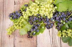 Grapes on wooden plank Stock Image
