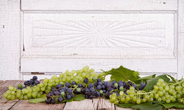 Grapes on wooden plank Stock Photography