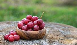 Grapes in  wooden plate outdoor in the garden Royalty Free Stock Image