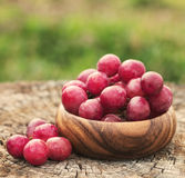 Grapes in wooden plate outdoor in the garden royalty free stock images