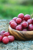 Grapes in wooden plate outdoor in the garden royalty free stock photos