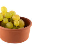 Grapes in wooden plate on white background Stock Photography