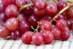 Grapes on a wooden table Royalty Free Stock Images