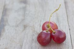 Grapes on a wooden table Royalty Free Stock Photo