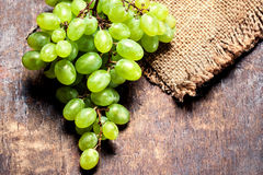 Grapes on a wooden table close up, rustic vintage style with c Royalty Free Stock Photo