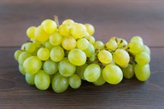 Grapes on a wooden table Royalty Free Stock Photography