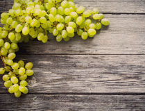Grapes on a wooden table Stock Photography