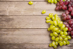 Grapes on a wooden table Stock Photos