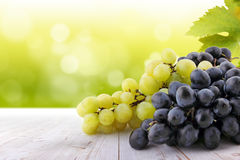 Grapes on wooden table Stock Photos