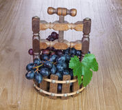 Grapes in a wooden vase Royalty Free Stock Photos