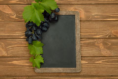 Grapes and writing board Royalty Free Stock Image