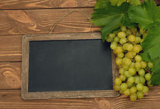 Grapes and writing board Royalty Free Stock Photography