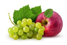 Grapes yellow pear and red apple with leaf. Isolated on white background. Clipping Path. Full depth of field royalty free stock images