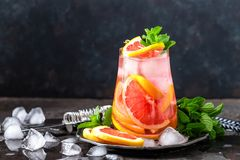 Grapefruit and fresh mint cocktail with juice, cold summer citrus refreshing drink or beverage with ice. Grapet and fresh mint cocktail with juice, cold summer Stock Images