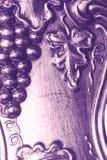 Grapevine design. Cluster of grapes, leaves, vine and flourish: antique silver design background Stock Photos