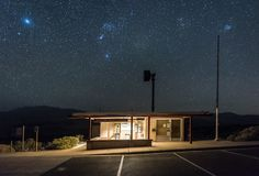 Grapevine Ranger Station at Death Valley at night with clear skies. stock image