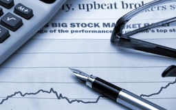Graph. Pen on stock-market graph in blue Royalty Free Stock Images