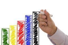 Graph. Man drawing an increasing bar/line graph - Business concept Stock Image