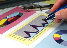 Graph analysis. Colorfull graphs hand and pen stock images