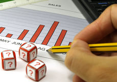 Graph analysis. Sales graph analysis and dice with question simbol royalty free stock photo