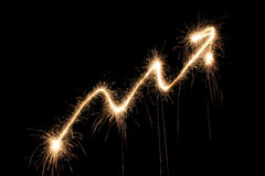 Graph arrow sparkler. Graph arrow up sparkler on dark Stock Photography