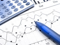 Graph and calculator (blue) Royalty Free Stock Photos