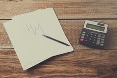 Graph with calculator on desk royalty free stock images