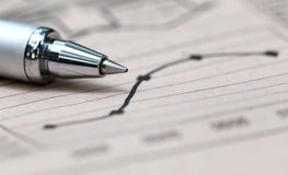 Graph chart  with pen. On paper Royalty Free Stock Photo